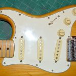 Pickguard screw holes were not properly positioned