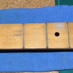 More cleaning. I also attempted to smooth out the worn area at the 3rd fret.