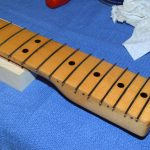 All frets in place. Note that each fret should have been trimmed a bit shorter beforehand.