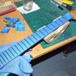 Preparing to polish frets