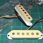 Naturally aged pickup covers donated from a 35 year old Squier Strat